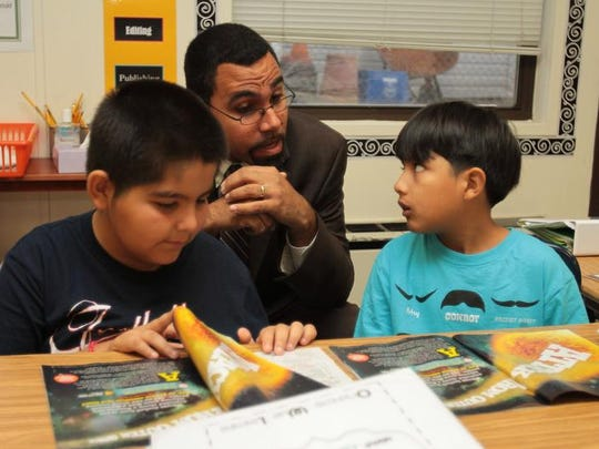 New York State Education Commissioner John King talks with third-graders Orlando Daza, left, and Daniel Siduenza as he tours John F. Kennedy Magnet School in Port Chester in October 2013.