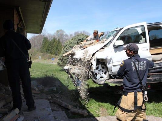 zan 0425 car into house 009.JPG