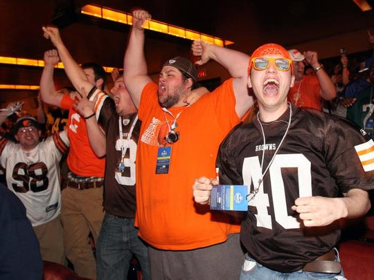 Cleveland Browns fans cheer after Texas A&M's Johnny Manziel was selected No. 22 by the team during Thursday's first round of the NFL draft at Radio City Music Hall in New York City.