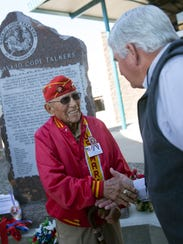 Navajo Code Talker John Kinsel Sr. shakes hands with Kirtland Mayor Mark Duncan Friday during an unveiling ceremony at the San Juan County Administration Offices in Aztec.