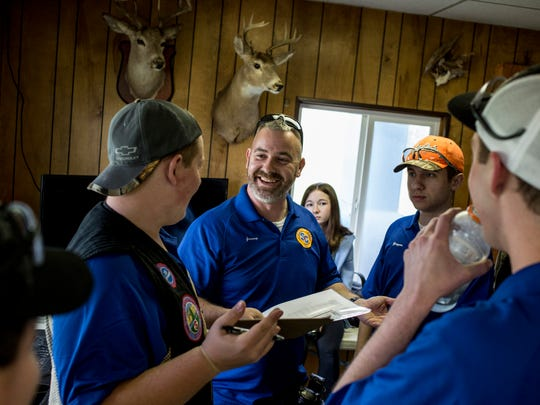 St. Clair High School coach Jeremy Danielson talks with his team during a Michigan State High School Clay Target League competition Wednesday, April 19, 2017 at the Blue Water Sportsman's Association in Kimball Township.
