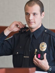 Burlington Police Officer Phillip Tremblay describes the body camera he was wearing the night he was called to the home of James Scarola and Colleen Bray during a hearing Friday at Vermont Superior Court in Burlington.