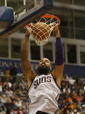 Phoenix Suns Tyson Chandler dunks a ball during a preseason scrimmage at Walkup Skydome at Northern Arizona University in Flagstaff on October 1, 2016.