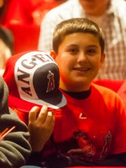 A young Mike Trout fan shows off his hat before the