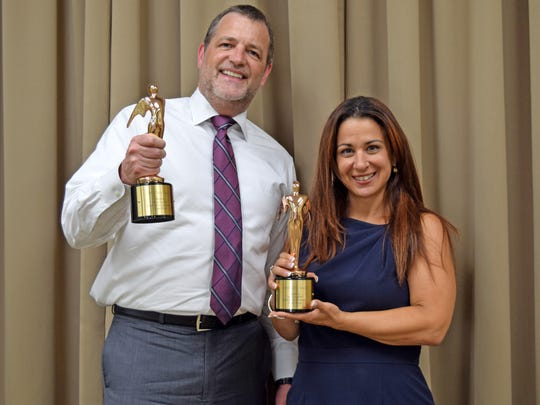 David Gentner, Wartburg president and CEO, and Angela Ciminello, Wartburg director of development and marketing, display Wartburg's 2016 Telly Award.