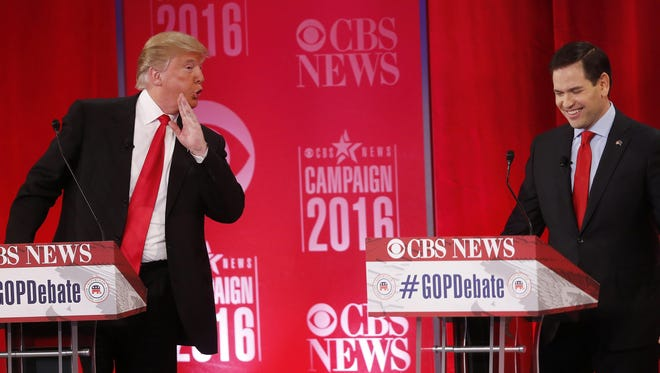 Donald Trump speaks to Sen. Marco Rubio of Florida during the Republican presidential debate this month in Greenville, S.C.