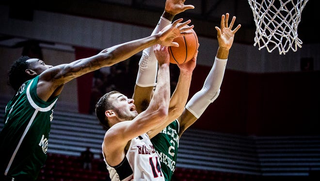 Ball State's Kyle Mallers fights for a shot past Eastern Michigan's defense during their game at Worthen Arena Tuesday, Jan. 2, 2018.
