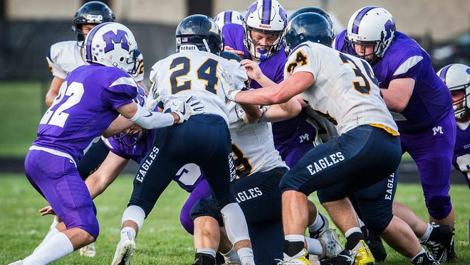 FILE -- Delta and Central play at Muncie Central High School on Friday, Aug. 17, 2018. After scrimmaging for years, the two Delaware County teams have opened up their seasons against one another for the past two years.