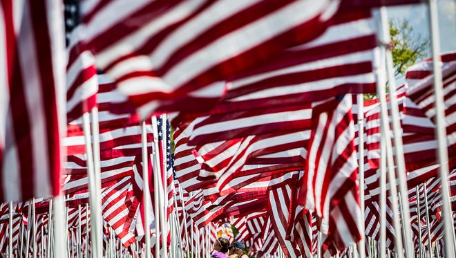 A thousand American flags fly at Minnetrista for the annual Flags of Honor event Wednesday afternoon. The flags will be on display through Sept. 11.