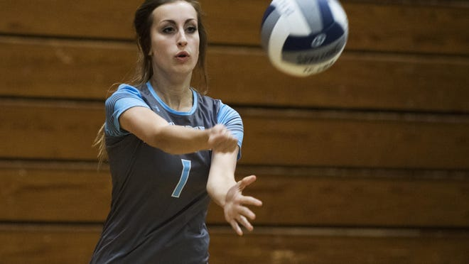 South Burlington's Eva Rawlings (1) serves the ball during the girls volleyball game against Burlington at Buck Hard Gym on Thursday afternoon.