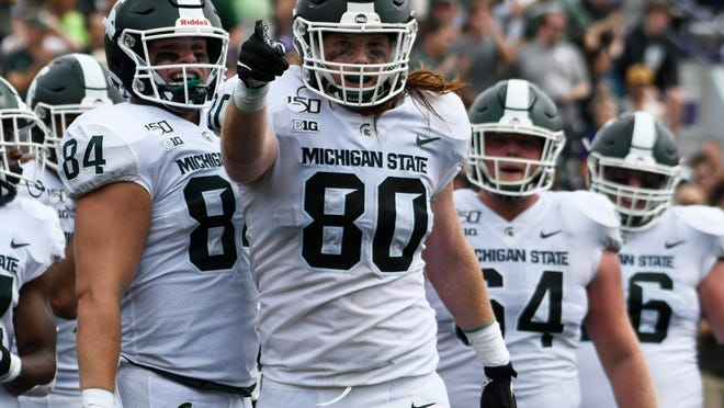 Michigan State tight end Matt Seybert (80) gestures after scoring a touchdown against Northwestern during the second half of an NCAA college football game, Saturday, Sept. 21, 2019, in Evanston, Ill. (AP Photo/David Banks)