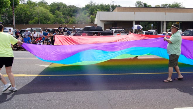 Members of PFLAG Silver City march in the 2015 Fourth of July  parade in Silver City. The organization will hold its fifth annual PFLAG scholarship benefit dance from 9 p.m. to midnight on Saturday at the Buckhorn Opera House in Pinos Altos. Proceeds fund the Nancy Kailing Scholarship at Western New Mexico University.