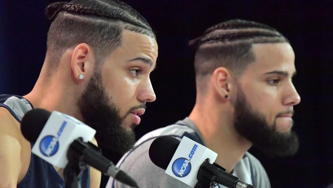 Nevada Wolf Pack forward Cody Martin (left) and forward Caleb Martin (right) address the media during a press conference the day before the first round of the 2018 NCAA Tournament at Bridgestone Arena