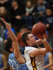 South Kitsap's Jackson Kambich (4) goes up for a shot against Rogers during the second half of Tuesday's game.