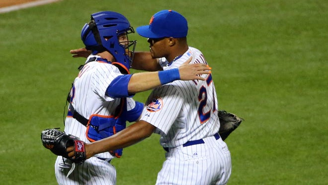 New York Mets left fielder Michael Cuddyer (23) and relief pitcher Jeurys Familia (27) celebrate the win against the Atlanta Braves at Citi Field.