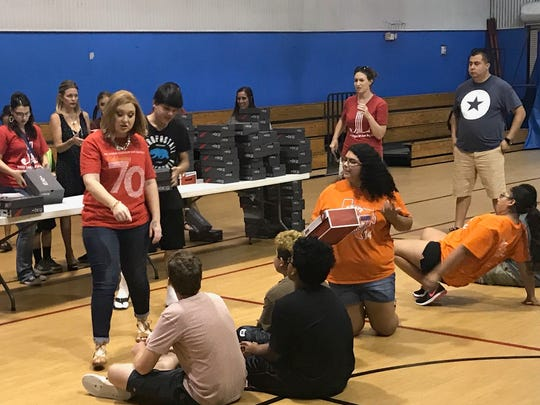 Junior League of San Angelo volunteers distribute new shoes to Boys and Girls Club members for the Shoes 4 Souls project.