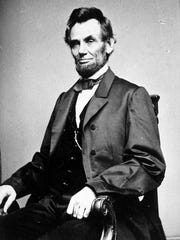 A photographic portrait is displayed showing Abraham Lincoln, the 16th president of the United States.