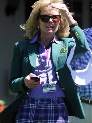 Member Darla Moore watches the action near the clubhouse during the third round of the 2013 Masters Tournament at Augusta National Golf Club on Saturday, April 13, 2013, in Augusta, Ga.