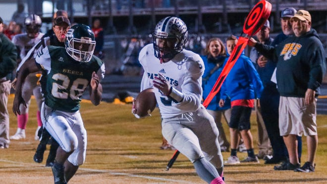 Powdersville's E.J. Humphrey (5) races for a touchdown against Berea during the first quarter Friday night.