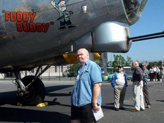 FILE: Jim Duddy, author of the Fuddy Duddy Column, checks out the namesake logo on the visiting warbird. Duddy died this week.