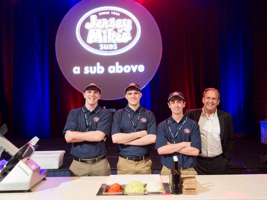 Jersey Mike's Founder & CEO Peter Cancro (right) is shown with three of his employees, who won first place in a company's sub-building competition here in Florida. The workers took home $30,000 for the win.