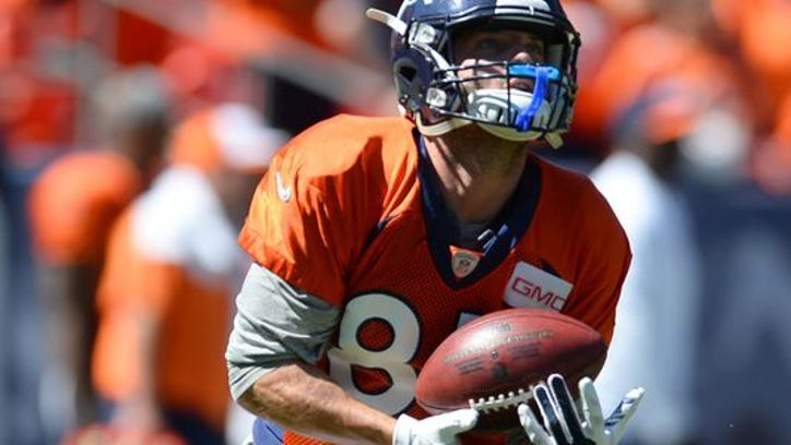 Denver Broncos wide receiver Wes Welker (83) practices kickoff returns prior to the start of a scrimmage at Sports Authority Field.