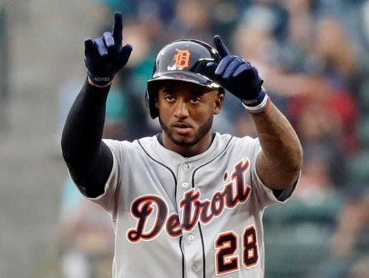 Detroit Tigers' Niko Goodrum motions toward the team's