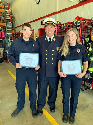 Sterling Fire Chief David Hurlbut (center) with recent fire training graduates firefighter Conner Wilbur and firefighter/paramedic Erin Cullinane.