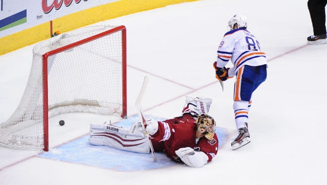 Edmonton Oilers center Sam Gagner (89) scores on Phoenix Coyotes goalie Thomas Greiss (1) during a shootout to win the game 3-2 at Jobing.com Arena on April 4, 2014.