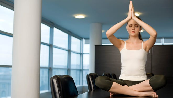 At Litzky Public Relations in Hoboken, N.J., workers clear out the meeting room for yoga lessons twice a week rather than practicing on the conference table.