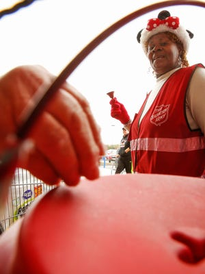 People make donations to the Salvation Army red kettle campaign.