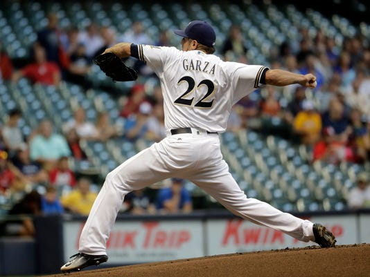 Milwaukee Brewers starting pitcher Matt Garza throws during the first inning of a baseball game against the St. Louis Cardinals Wednesday, Aug. 31, 2016, in Milwaukee. (AP Photo/Morry Gash)