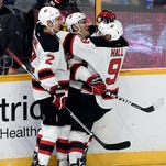 Improbable late rally gets Devils 5-4 OT win over Preds