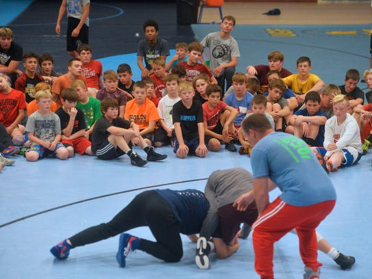 Young wrestlers watch a demonstration during the Zadick