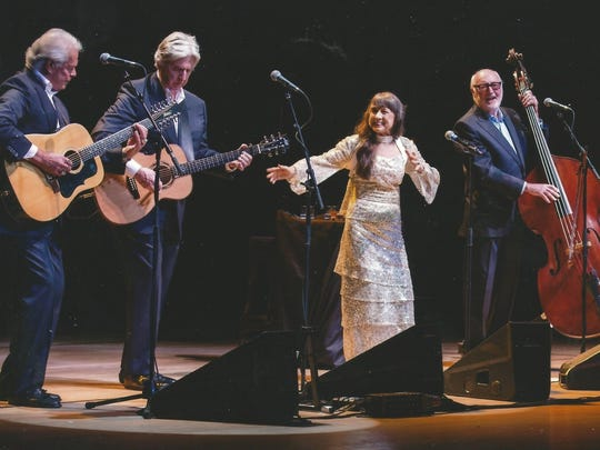 The Seekers onstage in the UK in 2014 during their