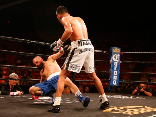 Miguel Flores just stares down at Raul Chirino as he hits the canvas for the first time in the fight. Flores would go onto win the fight by knockout in the second round.