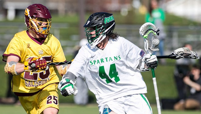 York College's Dillon Hannah, right, seen here in a file photo, had a career-high seven points on five goals and two assists in the Spartans' 16-4 win over Mary Washington on Saturday night. YORK DISPATCH FILE PHOTO
