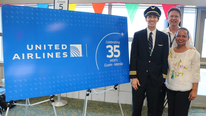 United Airlines held a gate ceremony to mark the 35th anniversary of its Guam-Manila route on July 5 at the Antonio B. Won Pat International Airport. From left: United First Officer Will Larsen; Capt. Pierre Frenay, United's chief pilot, Guam flight operations; and Paula Monk, United's senior manager of sales, Guam/Micronesia.