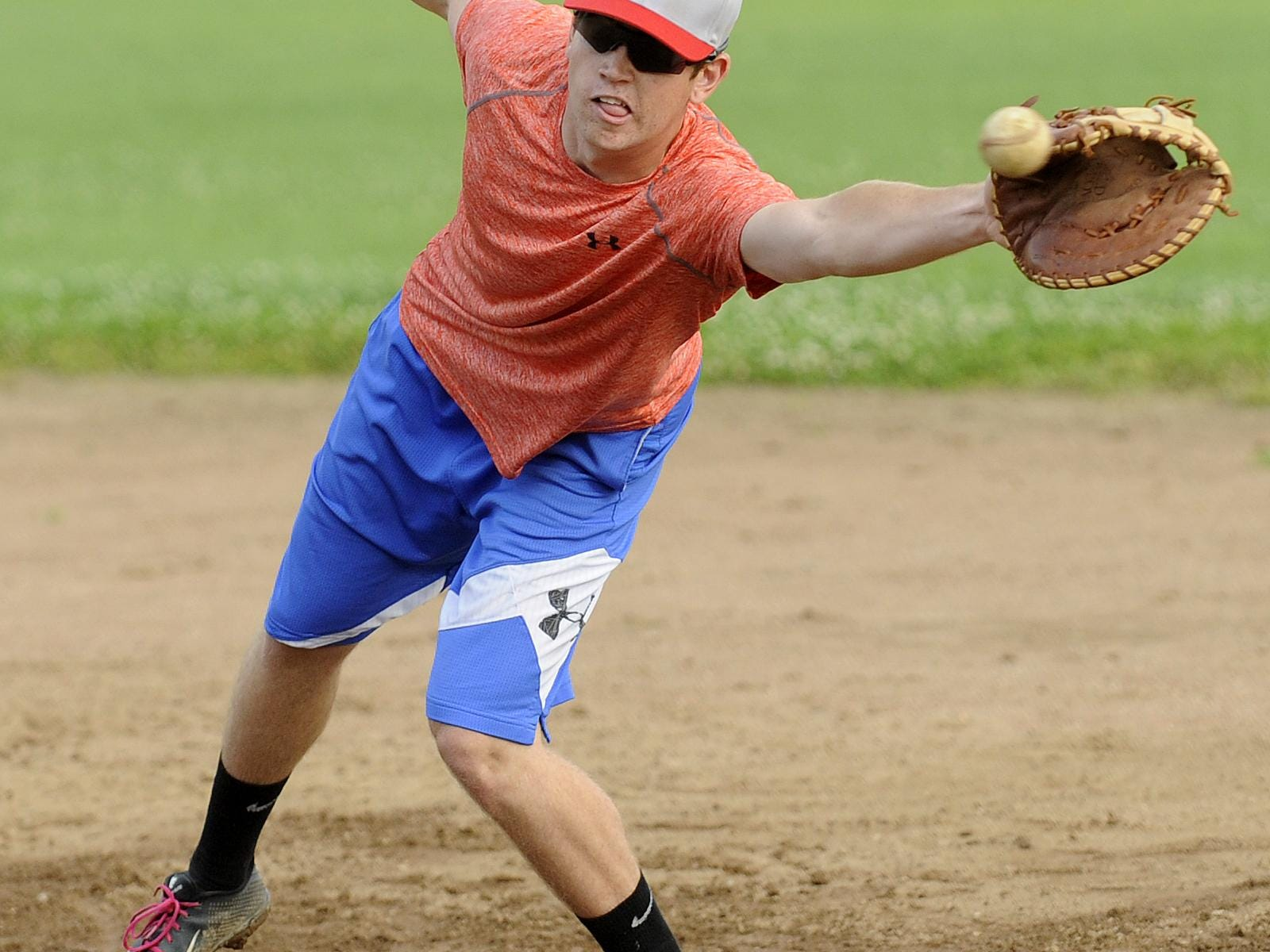 Granville graduate Ryan Blessard reaches for the ball at first base during a recent Utica Post 92 practice at Newark High School.