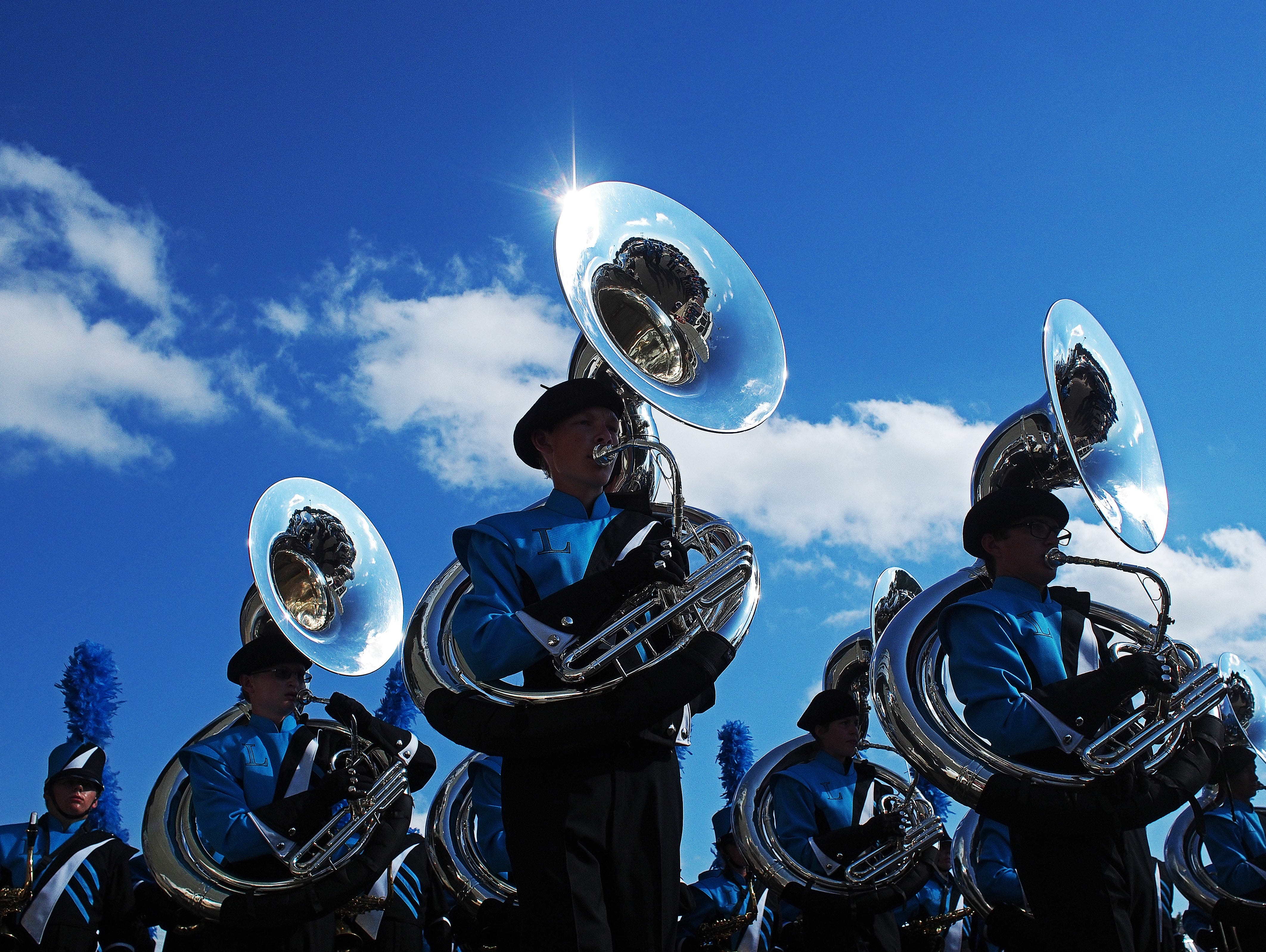 The Lincoln High School marching band performs before a football game between Lincoln and Rapid City Stevens Saturday, Aug. 27, 2016, at Howard Wood Field in Sioux Falls.