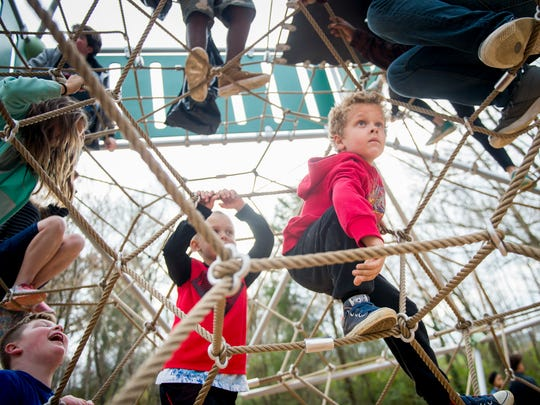 South-Doyle Middle School students play on the new Baker Creek playground in South Knoxville on Wednesday, Nov. 15, 2017.