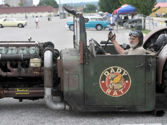 """This unit is called a rat rod by design. And this is the biggest rat rod we've seen, so we call it 'The daddy of all rats,'""said John Stauffer of Lancaster County. It is a vehicle that he and his son, Todd, built and brought to the York Expo Center on Thursday. According to Stauffer, he, his son and grandson, Cordell, put in approximately 1,500 hours building the rod, which has parts from an Ingersoll Rand bulldozer, a military vehicle, a school bus and sports a horn from a Nathan P5 Union Pacific Locomotive."