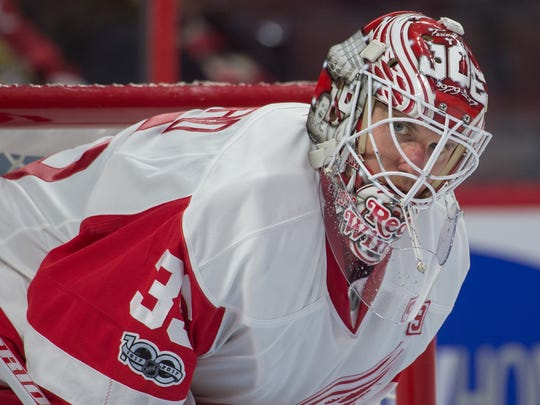 Jimmy Howard warms up before the second period of the