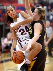 Lebanon's Jasmine Turner (24) collides with a Solanco defender on the way to the basket.