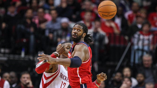 Washington Wizards power forward Nene Hilario (42) attempts to get a loose ball during the fourth quarter against the Houston Rockets at Toyota Center.