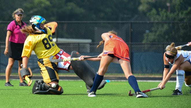 Pocomoke's Dom Farrace makes a sliding save against Delmar on Saturday, Sept. 10, 2016, in Pocomoke.