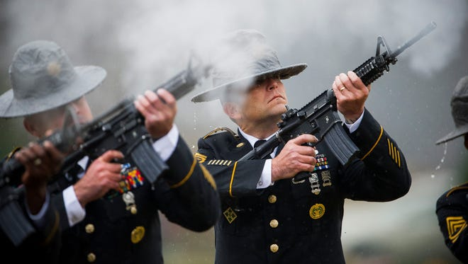 Army Sgt. 1st Class Elijah Conway, right, shoots during a 21-gun salute for Army Pfc. Tyler Iubelt at Sunset Memorial Park to In Du Quoin, Ill, Wednesday, Nov. 23, 2016. Iubelt, 20, died of injuries inflicted by an improvised explosive device in Afghanistan on Nov. 12.