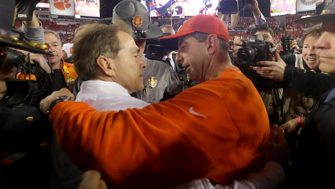 Alabama coach Nick Saban congratulates Clemson coach Dabo Swinney after the Tigers defeated the Crimson Tide 35-31 in the 2017 College Football Playoff National Championship Game on Jan. 9, 2017.