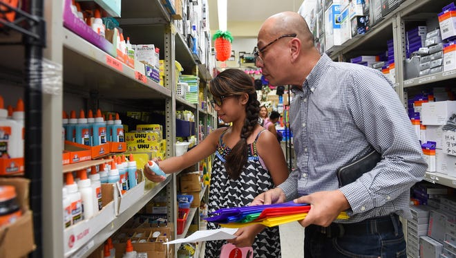 St. Francis Catholic School student Julianne Robles, 10, does some back-to-school shopping with guardian Mark Enriquez at National Office Supply in Tamuning on July 31, 2017. The first school day for Guam Department of Education classes will be on Aug. 17.