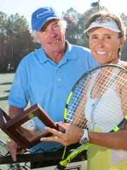 Lucien Woorons, left, and his daughter Sophie Woorons, who teach tennis at Brookstone Meadows in Anderson, won a national title as a Super Senior father daughter doubles team on a clay court in Florida.